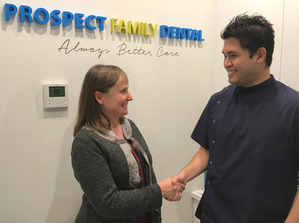 Shekinah House co-founder Louise Cowan accepts a $500 donation from Prospect Family Dental owner Dr Bing Lee.